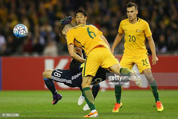 Takuma Asano of Japan kicks Matthew Spiranovic of the Socceroos in the head after an attempt for goal during the 2018 FIFA World Cup Qualifier match...
