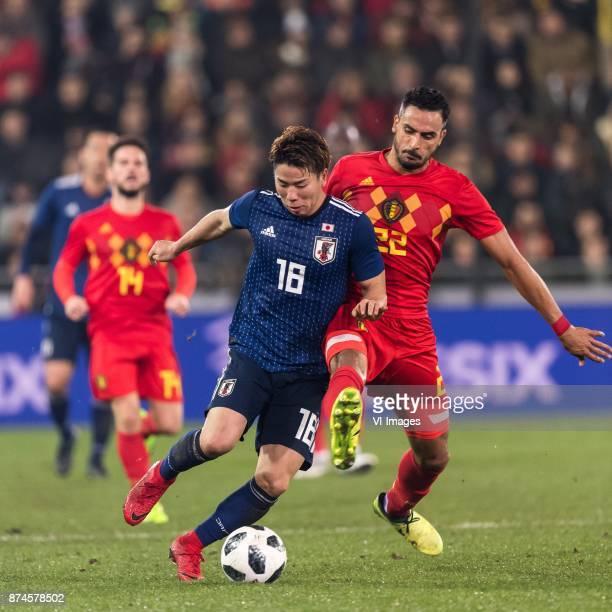 Takuma Asano of Japan Nacer Chadli of Belgium during the friendly match between Belgium and Japan on November 14 2017 at the Jan Breydel stadium in...