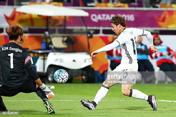 Takuma Asano of Japan scores his team's first goal during the AFC U23 Championship final match between South Korea and Japan at the Abdullah Bin...