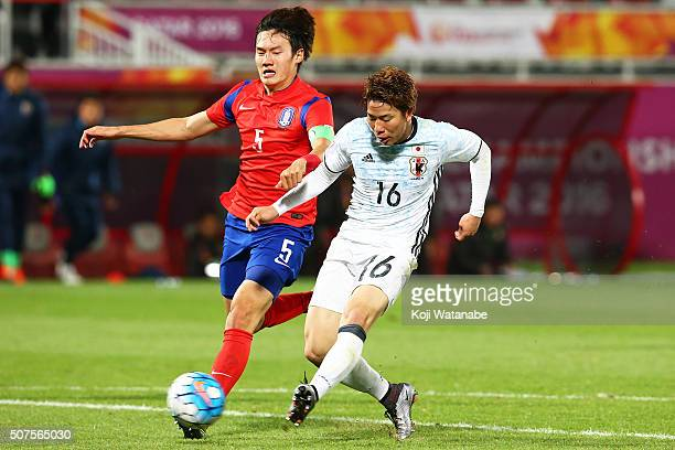 Takuma Asano of Japan scores his team's third goal during the AFC U23 Championship final match between South Korea and Japan at the Abdullah Bin...
