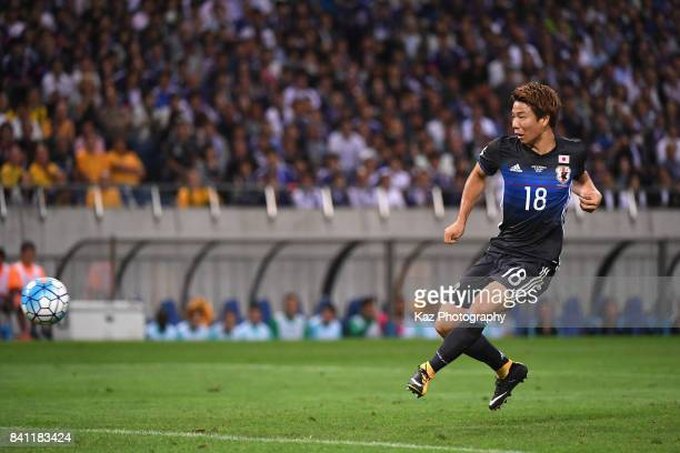 Takuma Asano of Japan scores the opening goal during the FIFA World Cup Qualifier match between Japan and Australia at Saitama Stadium on August 31...