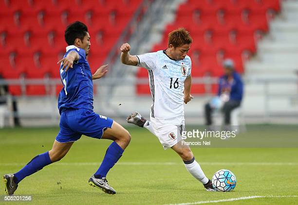 Takuma Asano of Japan takes a shot on goal during the AFC U23 Championship Group B match between Thailand and Japan at Grand Hamad Stadium on January...