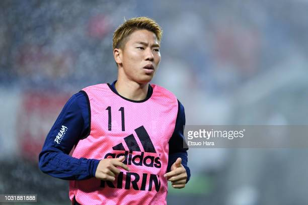 Takuma Asano of Japan warms up during the international friendly match between Japan and Costa Rica at Suita City Football Stadium on September 11...