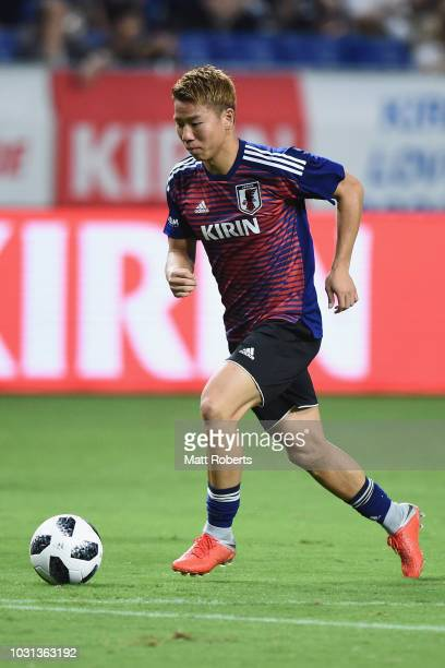 Takuma Asano of Japan warms up on the field prior to the international friendly match between Japan and Costa Rica at Suita City Football Stadium on...