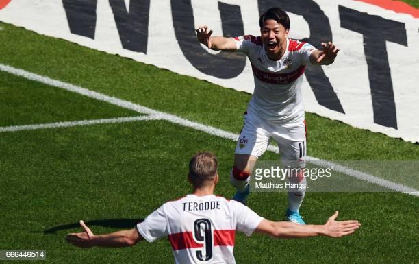 Takuma Asano of Stuttgart celebrates his team's first goal with team mate Simon Terodde during the Second Bundesliga match between VfB Stuttgart and...