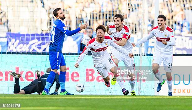 Takuma Asano of Stuttgart celebrates the first goal for his team with Emiliano Insua of Stuttgart and Marcin Kaminski of Stuttgart during the Second...