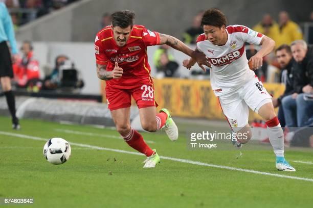Takuma Asano of Stuttgart Christopher Trimmel of Union Berlin battle for the ball during the Second Bundesliga match between VfB Stuttgart and 1 FC...