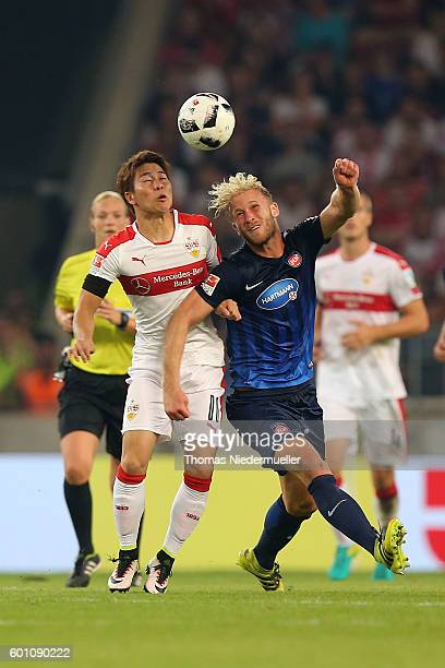 Takuma Asano of Stuttgart fights for the ball with Sebastian Griesbeck during the Second Bundesliga match between VfB Stuttgart and 1 FC Heidenheim...