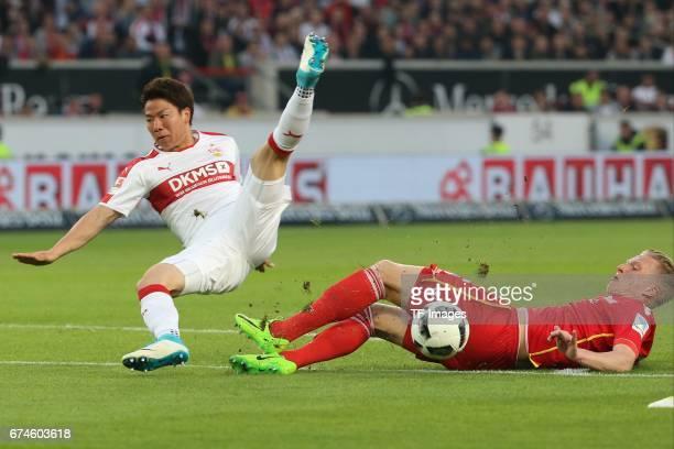 Takuma Asano of Stuttgart Kristian Pedersen of Union Berlin battle for the ball during the Second Bundesliga match between VfB Stuttgart and 1 FC...