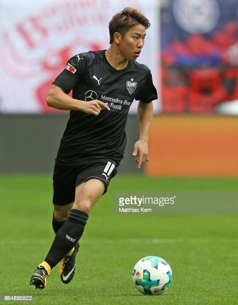Takuma Asano of Stuttgart runs with the ball during the Bundesliga match between RB Leipzig and VfB Stuttgart at Red Bull Arena on October 21 2017 in...