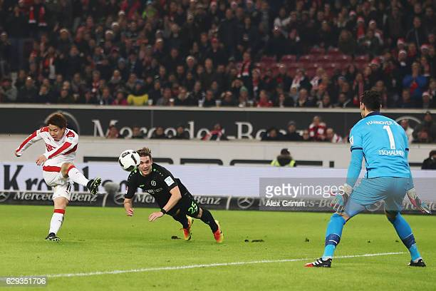 Takuma Asano of Stuttgart tries to score against Oliver Sorg and goalkeeper Philipp Tschauner of Hannover during the Second Bundesliga match between...