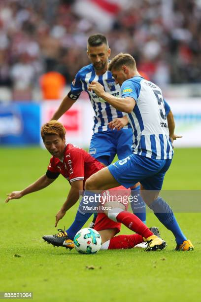Takuma Asano of VfB Stuttgart and Niklas Stark of Hertha BSC Berlin and Vedad Ibisevic of Hertha BSC Berlin during the Bundesliga match between...