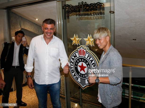Takuma Asano poses for photo with head coach Savo Milosevic after signing for Partizan Belgrade on August 3, 2019 in Belgrade, Serbia.