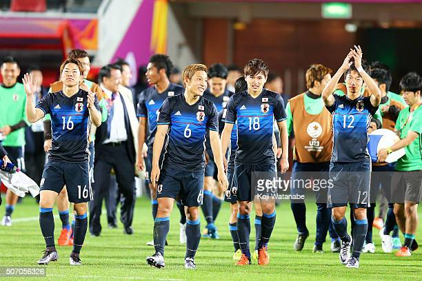 Takuma Asano Ryosuke Yamanaka Takumi Minamino amd Sei Muroya of Japan celebrate qualifying for the Rio de Janeiro Olympics after winning the AFC U23...