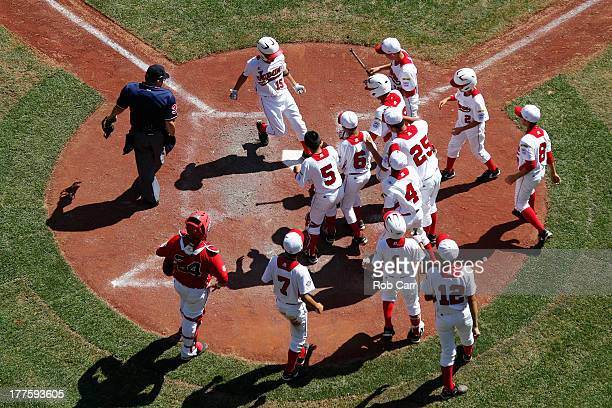 Takuma Gomi of the Tokyo Japan team celebrates after hitting a solo home run against the Tijuana Mexico team during the third inning of the...
