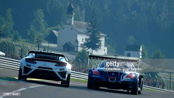 Takuma Miyazono and Ryota Kokubun of Japan battle for the race lead in the closing stages of race one during the FIA Gran Turismo Championship Asia &...