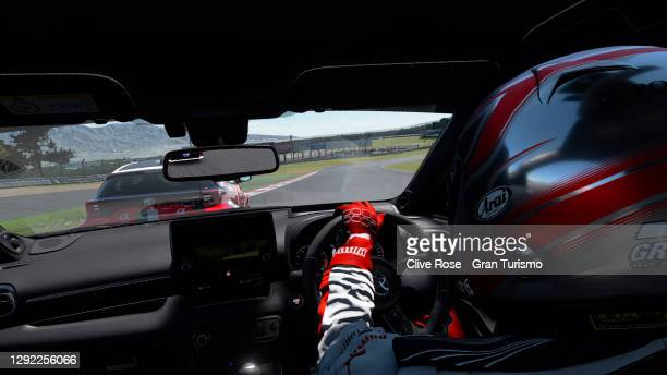 Takuma Miyazono of Japan leads the field at the start of the Nations Cup race one of the FIA Gran Turismo World Tour 2020 Finals run at the virtual...
