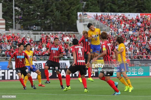 Takuma Nishimura of Vegalta Sendai and Akito Fukumori of Consadole Sapporo compete for the ball during the JLeague J1 match between Consadole Sapporo...