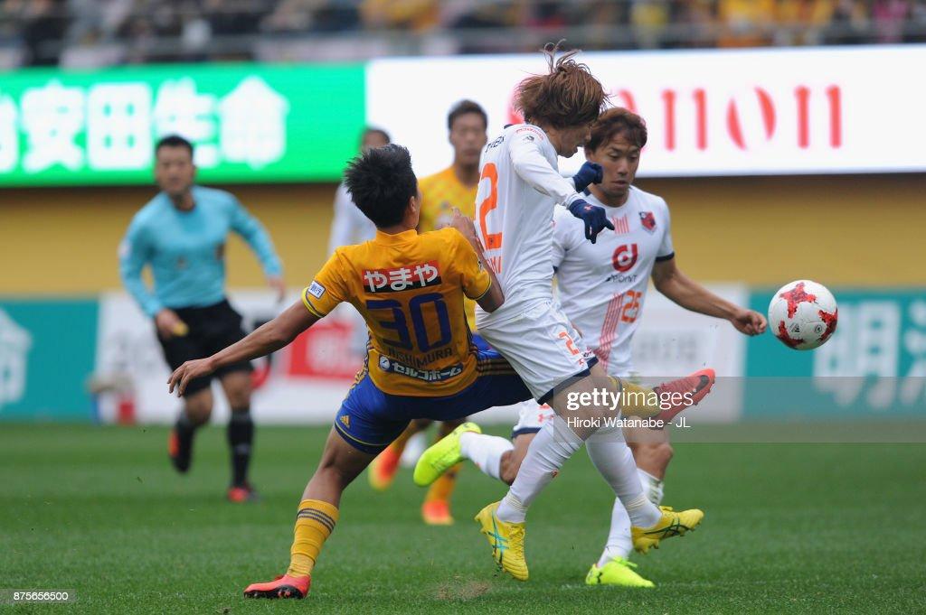 Takuma Nishimura of Vegalta Sendai and Takuya Wada of Omiya Ardija during the J.League J1 match between Vegalta Sendai and Omiya Ardija at Yurtec Stadium Sendai on November 18, 2017 in Sendai, Miyagi, Japan.