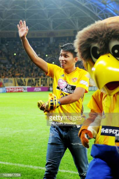 Takuma Nishimura of Vegalta Sendai applauds fans during his sending off ceremony as he moves to CSKA Moscow after the JLeague J1 match between...
