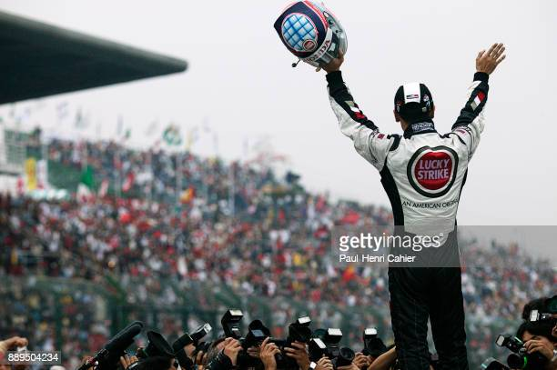 Takuma Sato BARHonda 005 Grand Prix of Japan Suzuka Circuit 12 October 2003 Takuma Sato saluting his fans after the finish of the 2003 Japanese Grand...
