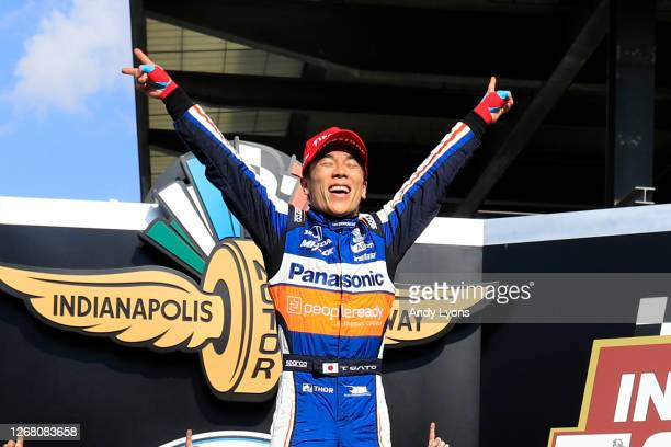 Takuma Sato, driver of the Panasonic / PeopleReady Rahal Letterman Lanigan Racing Honda, celebrates in Victory Lane after winning the 104th running...