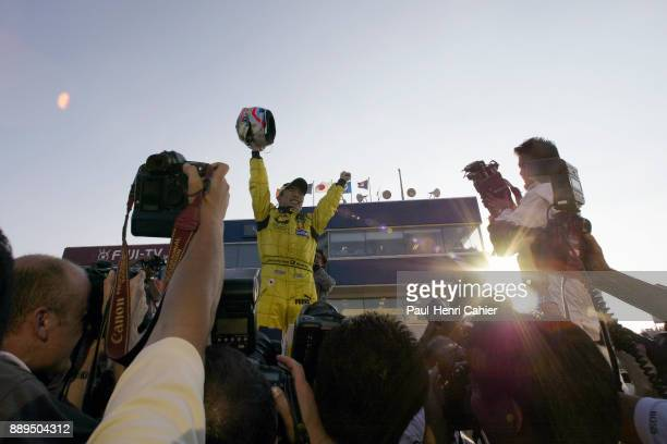 Takuma Sato JordanHonda EJ12 Grand Prix of Japan Suzuka Circuit 13 October 2002 Takuma Sato saluting his fans after the finish of the 2002 Japanese...