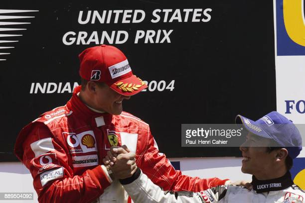 Takuma Sato Michael Schumacher BARHonda 006 Grand Prix of the United States Indianapolis Motor Speedway 20 June 2004 Takuma Sato is congratulated by...