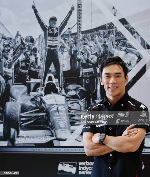 Takuma Sato of Japan and Andretti Autosport Honda poses for photographs during the Asahi Shimbun interview on June 13 2017 in Tokyo Japan