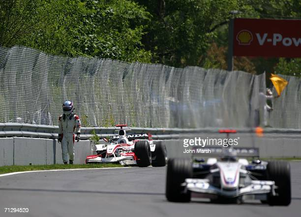 Takuma Sato of Japan and BAR Honda walks away from his wrecked car during the Canadian Formula One Grand Prix at the GillesVilleneuve Circuit on June...