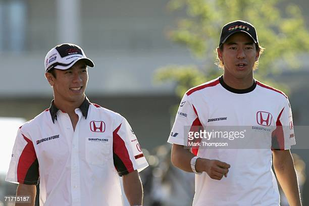 Takuma Sato of Japan and Super Aguri F1 with team mate Sakon Yamamoto of Japan in the paddock after second practice for the Turkish Formula One Grand...