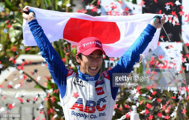 Takuma Sato of Japan driver of the ABC Supply A J Foyt Racing Dallara Honda celebrates after winning the IndyCar Series Toyota Grand Prix of Long...