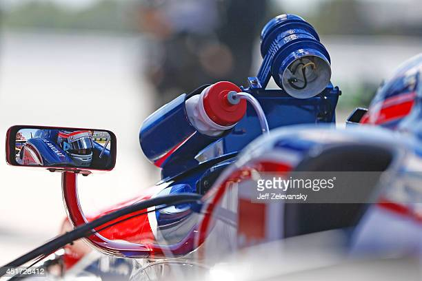 Takuma Sato of Japan driver of the ABC Supply AJ Foyt Racing Honda sits in his car during practice for the Pocono INDYCAR 500 at Pocono Raceway on...