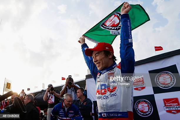 Takuma Sato of Japan driver of the ABC Supply AJ Foyt Racing Honda celebrates winning the Verizon P1 Pole Award for the Verizon IndyCar Series...
