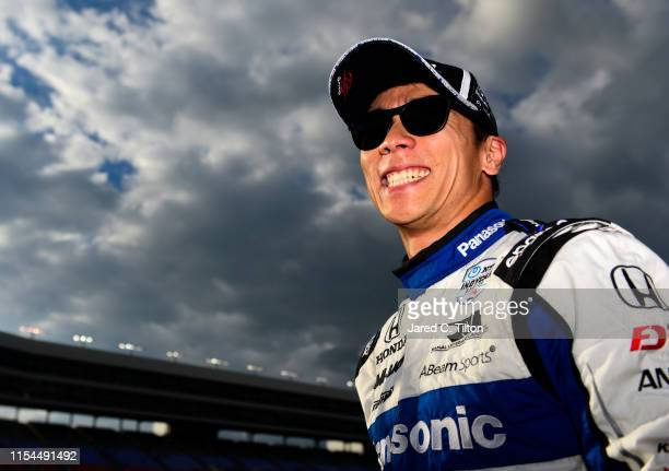 Takuma Sato of Japan driver of the ABeam Consulting Honda stands on the grid after posting the quickest lap during US Concrete Qualifying Day for the...