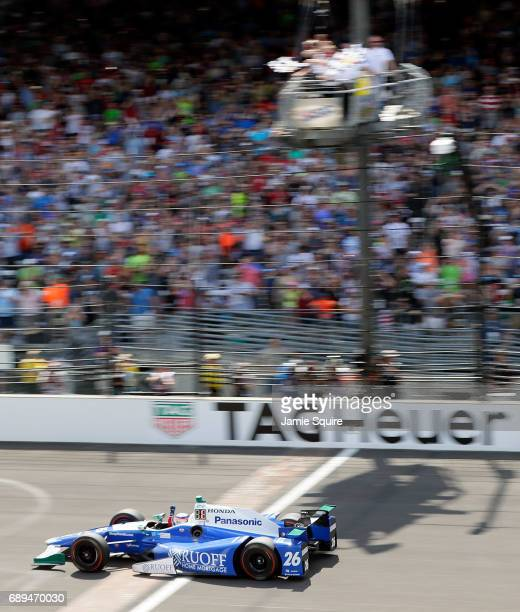 Takuma Sato of Japan driver of the Andretti Autosport Honda crosses the finish line to win the 101st running of the Indianapolis 500 at Indianapolis...