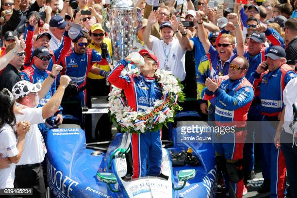 Takuma Sato of Japan, driver of the Andretti Autosport Honda, celebrates in Victory Lane after winning the 101st running of the Indianapolis 500 at...
