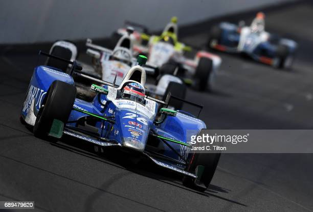 Takuma Sato of Japan driver of the Andretti Autosport Honda leads a pack of cars during the 101st Indianapolis 500 at Indianapolis Motorspeedway on...