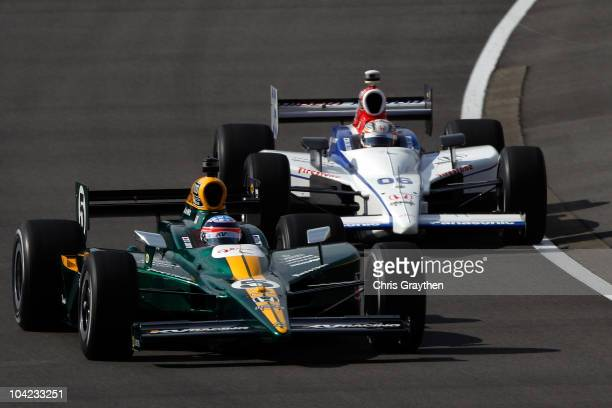 Takuma Sato of Japan driver of the LotusKV Racing Technology Dallara Honda leads Hideki Mutoh of Japan driver of the Formula Dream/Panasonic Dallara...