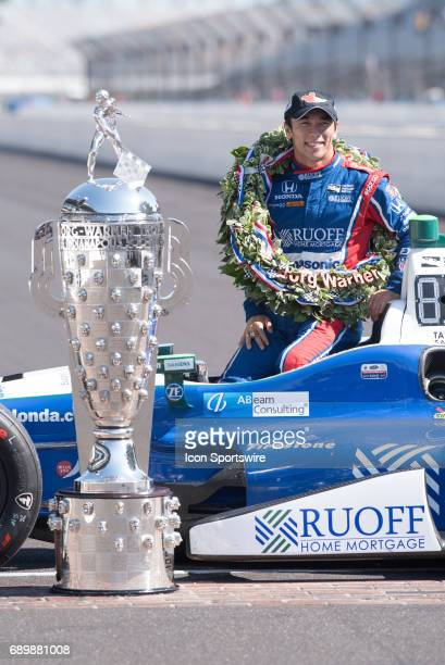Takuma Sato with the Borg Warner Trophy during his Day After Winner's Photo Shoot for the 101st Indianapolis 500 on May 29 at the Indianapolis Motor...