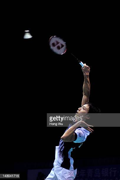 Takuma Ueda of Japan plays a shot during his match against Zhou Wenlong of China during day Two of the 2012 Badminton Asia Championships at Qingdao...