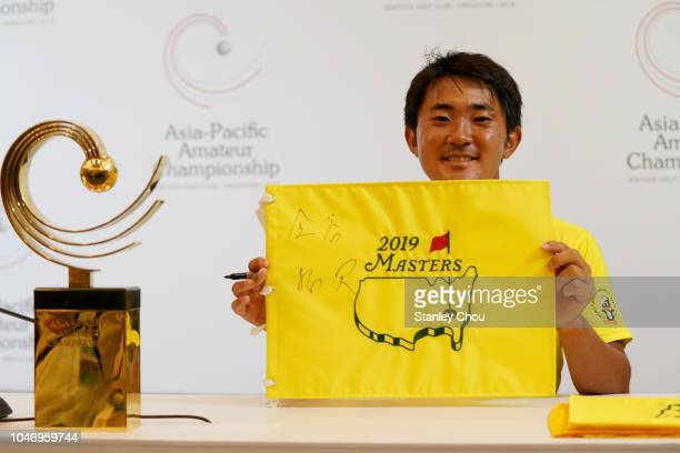 Takumi Kanaya of Japan poses with the 2019 US Master pin flag and the 2018 Asia Pacific Amateur Golf Championship trophy after he won it by 13 under...