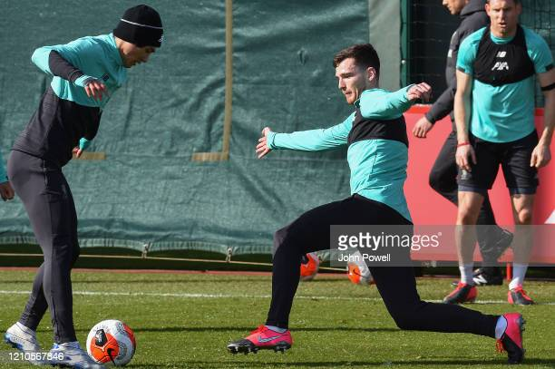 Takumi Minamino and Andy Robertson of Liverpool during a training session at Melwood Training Ground on March 05 2020 in Liverpool England