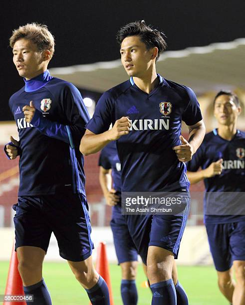 Takumi Minamino and Japanese players warm up during a training session on July 22 2016 in Aracaju Brazil