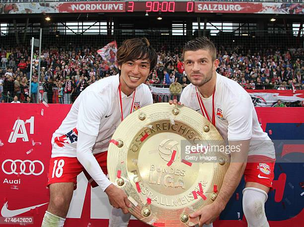 Takumi Minamino and Valon Berisha of Salzburg celebrate with the trophy for winning the Austrian Soccer Championship after the tipico Bundesliga...