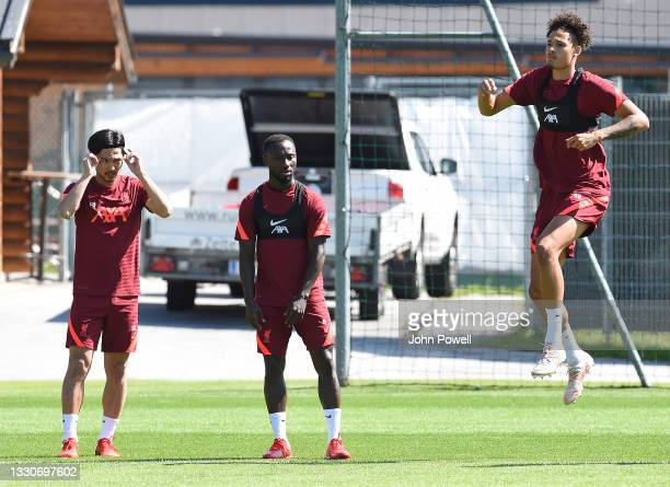 Takumi Minamino, Naby Keita and Rhys Williams of Liverpool during a training session on July 26, 2021 in UNSPECIFIED, Austria.