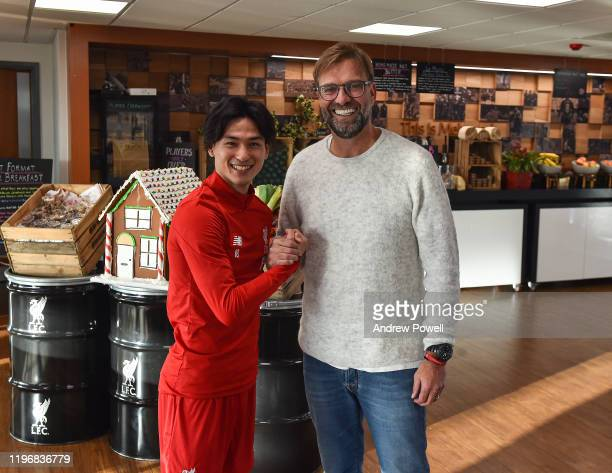 Takumi Minamino new signing of Liverpool on his first day with Jurgen Klopp manager of Liverpool at Melwood Training Ground on December 31 2019 in...