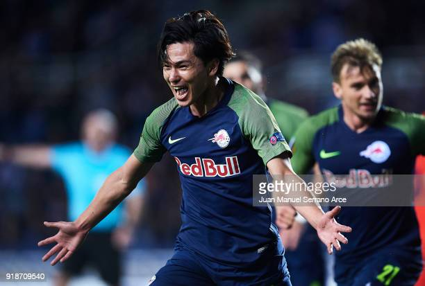 Takumi Minamino of FC Red Bull Salzburg celebrates after scoring during UEFA Europa League Round of 32 match between Real Sociedad and FC Red Bull...