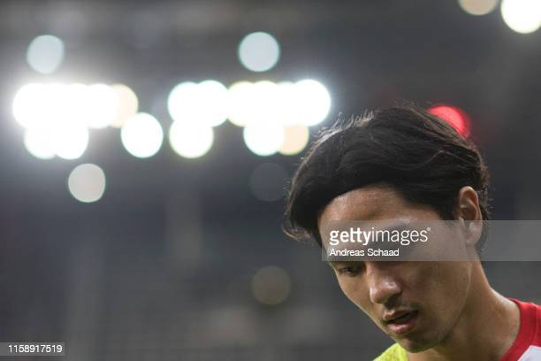 Takumi Minamino of FC Red Bull Salzburg warms up during the preseason friendly match between RB Salzburg and FC Chelsea at Red Bull Arena on July 31...