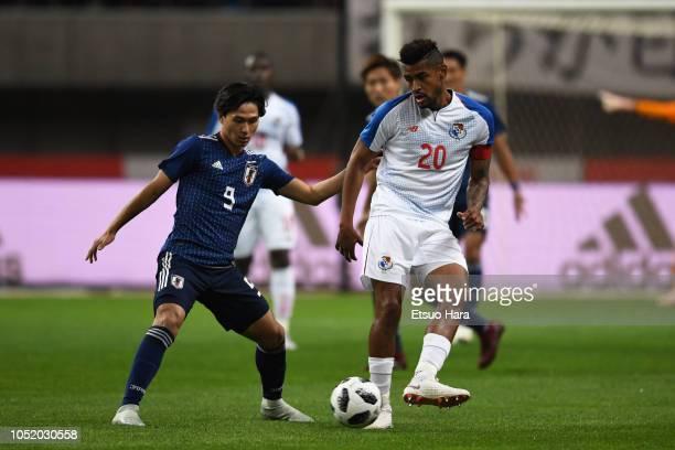 Takumi Minamino of Japan and Anibal Godoy of Panama compete for the ball during the international friendly match between Japan and Panama at Denka...